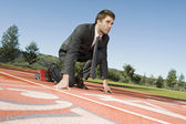 Businessman At The Starting Blocks — Stock Photo