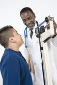 Doctor Checking Boy's Weight — Stock Photo