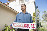 Man Holding. Foreclosure Sign — Stock Photo