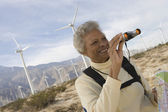 Mature Woman With Binoculars At Wind Farm — Stock Photo