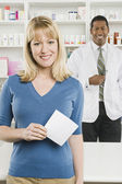 Woman Picking Up Prescription Drugs At Pharmacy — Stock Photo