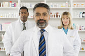 Three Confident Pharmacists Standing At Pharmacy — Stock Photo