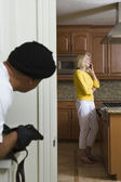 Burglar With Gun Peeking At Woman — Stock Photo