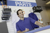 Low angle view of car mechanic standing at the counter — Stock Photo