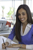 Portrait of woman signing papers — Stok fotoğraf