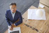 Top view of manager using laptop on plywood in warehouse — Stock Photo