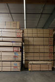 Stack of wooden plywood with markings in warehouse — Stock Photo