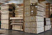 Stacks of plywood piled up in warehouse — Stock Photo