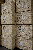 Close-up of stacks of plywood in warehouse — Stock Photo