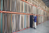 Manager holding plywood — Stock Photo