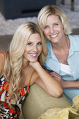 Portrait of beautiful young woman with her mother — Stock Photo