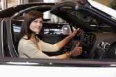 Woman having a test drive — Stock Photo