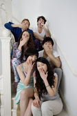 Group portrait of young friends yawning — Stock Photo
