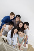 Group portrait of friends on stairway — Stock Photo