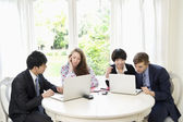 Group of businesspeople working on laptop — Stock Photo