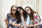 Women sleeping on sofa while wearing sunglasses — Stock Photo