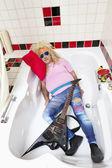 Drunk man asleep in bathtub — Stock Photo