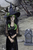 Portrait of young girl costumed as a witch — Stock Photo