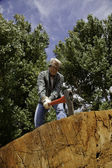 Low angle view of man chopping wood — Stock Photo