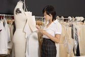 Side view of woman working in her clothing store — Stock Photo