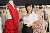 Young woman standing near the mannequin — Stock Photo