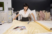Fashion designer working at desk — Stock Photo