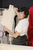 Fashion designer working in cloth design store — Stock Photo
