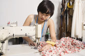 Fashion designer sewing fabric — Stock Photo