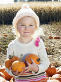 Portrait of a happy girl holding pumpkins in farm — Stock Photo