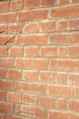 Close-up of reddish-brown brick wall — Stock Photo