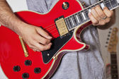 Midsection of man playing electric guitar — Stock Photo