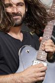 Casual man playing guitar — Stock Photo