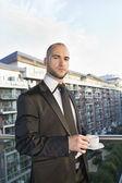 Portrait of confident businessman having cup of tea — Stock Photo
