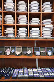 Shirts, neckties and hand cuff links displayed on shelves — Stock Photo