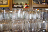 Upturned glasses at a pub counter — Stock Photo