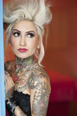 Tattooed young woman looking away — Stock Photo