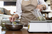 Midsection of an employee measuring ingredient on weight scale in spice store — Foto Stock