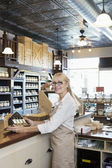 Portrait of a senior spice merchant standing at counter in store — Stock Photo