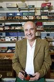Portrait of a mature tobacco shop owner — Stock Photo