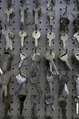 Large group of keys hanging on hooks in store — Stock Photo