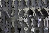 Keys hanging on hooks in store — Stock Photo