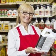 Stock Photo: Portrait of senior womholding cin retail store