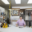 Stock Photo: Portrait of senior owner in workshop
