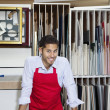 Foto Stock: Portrait of happy skilled worker in workshop