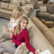 Portrait of a happy mother and daughter in furniture store — Stock Photo #21880845