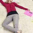 Young woman lying on new mattress in furniture store — Stock Photo