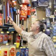 Mature salesperson working in hardware store — Stock Photo
