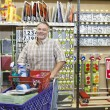 Portrait of a mature man with shopping cart in hardware store — Stock Photo