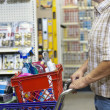 Midsection of man with shopping cart in hardware store — Stock Photo