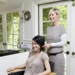Stock Photo: Happy customer with hairstylist in beauty salon